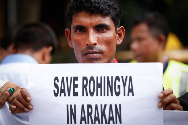 Myanmar Rohingya refugees in Malaysia hold placards during a protest near the Myanmar embassy in Kuala Lumpur, Malaysia, on Wednesday, March 11, 2015. Myanmar's President Thein Sein and his wife are expected to visit Malaysia from March 12 to 13. (AP Photo/Vincent Thian)